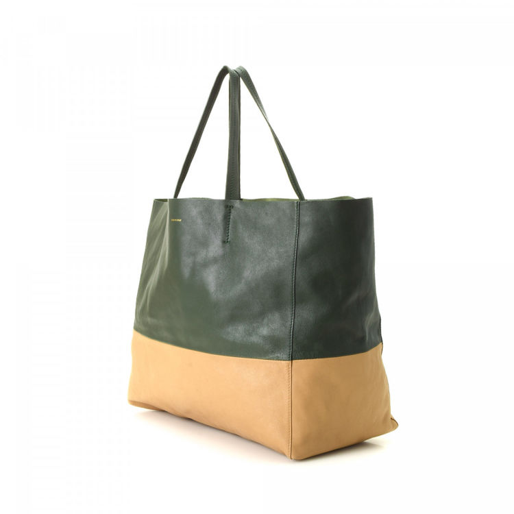 b5f95877cd7 The authenticity of this vintage Céline Bi-Cabas Horizontal tote is  guaranteed by LXRandCo. Crafted in leather