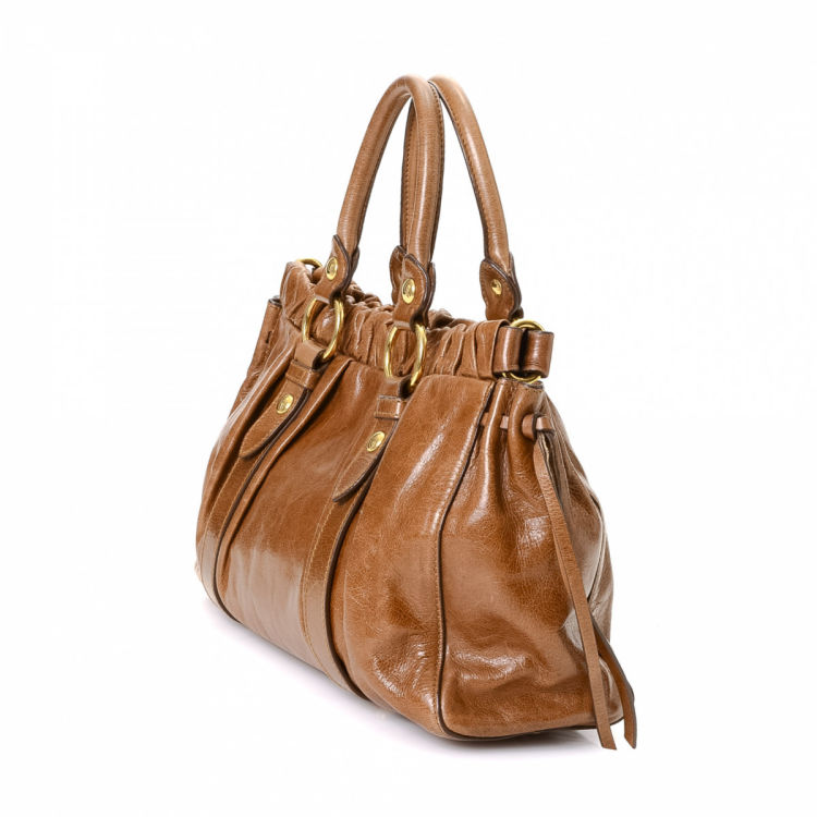 da12ba3c5d9 The authenticity of this vintage Miu Miu Gathered Leather Two Way Bag  handbag is guaranteed by LXRandCo. This refined pocketbook was crafted in vitello  lux ...