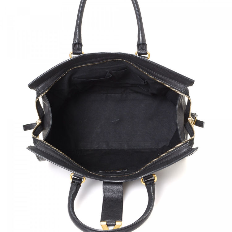 f7b8ec55e0dc LXRandCo guarantees this is an authentic vintage Yves Saint Laurent Cabas  Chyc Medium handbag. This iconic bag was crafted in leather in beautiful  black.