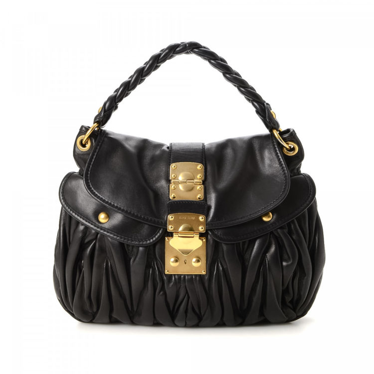 1012755e55b5 LXRandCo guarantees the authenticity of this vintage Miu Miu Coffer  shoulder bag. This practical pocketbook was crafted in nappa gaufré leather  in black.