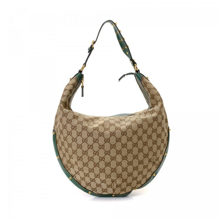 cf135ebd3bf LXRandCo guarantees this is an authentic vintage Gucci Hobo Bag shoulder bag.  This chic purse in beige is made in gg canvas. Due to the vintage nature of  ...