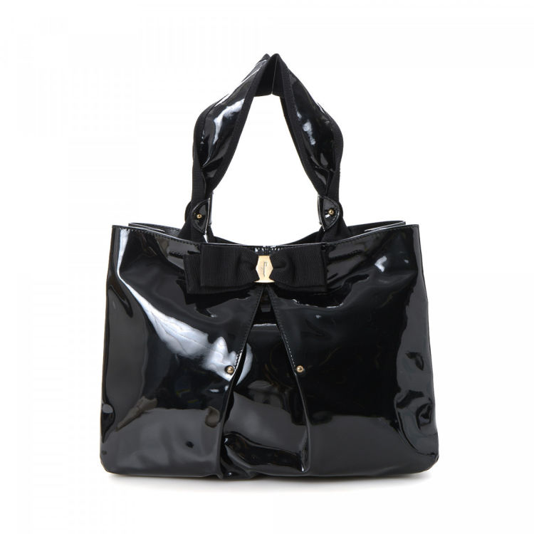 604648b275 LXRandCo guarantees this is an authentic vintage Ferragamo tote. Crafted in patent  leather