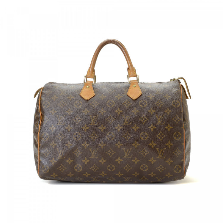7ec493e9dd5d The authenticity of this vintage Louis Vuitton Speedy 35 handbag is  guaranteed by LXRandCo. This everyday bag in beautiful brown is made in  monogram coated ...