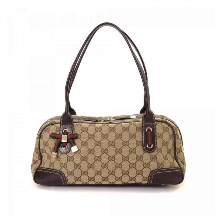 9ffd23df697 The authenticity of this vintage Gucci Princy shoulder bag is guaranteed by  LXRandCo. Crafted in gg canvas