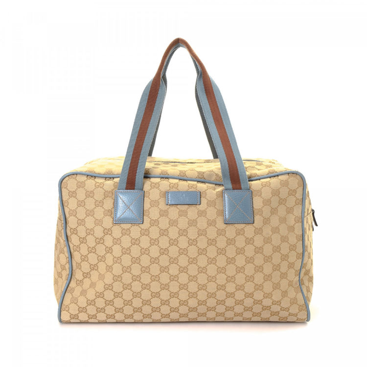 150228feded LXRandCo guarantees the authenticity of this vintage Gucci travel bag. This  signature weekender in beautiful beige is made in gg canvas.