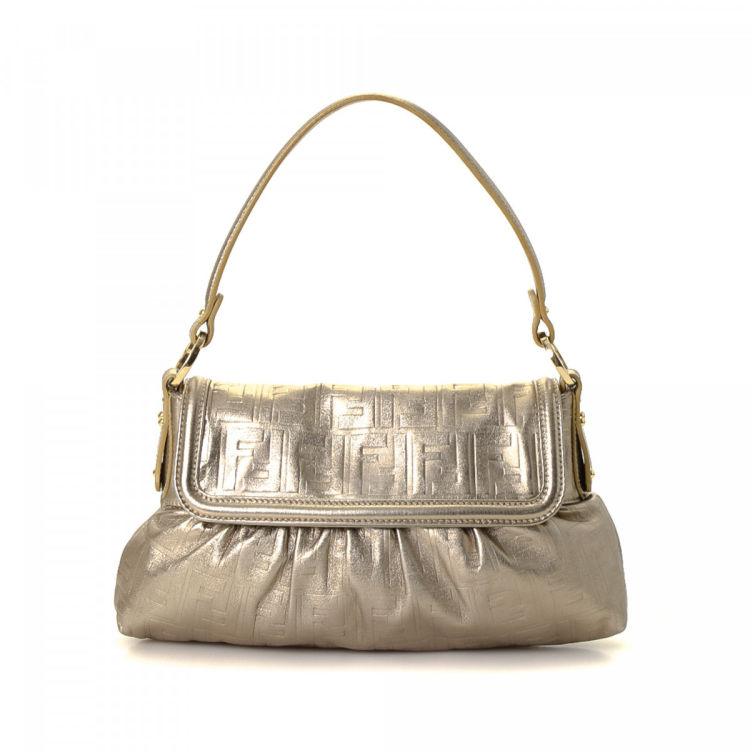 d4ae74bb3c LXRandCo guarantees this is an authentic vintage Fendi Zucca shoulder bag.  This iconic satchel was crafted in leather in beautiful metallic bronze.