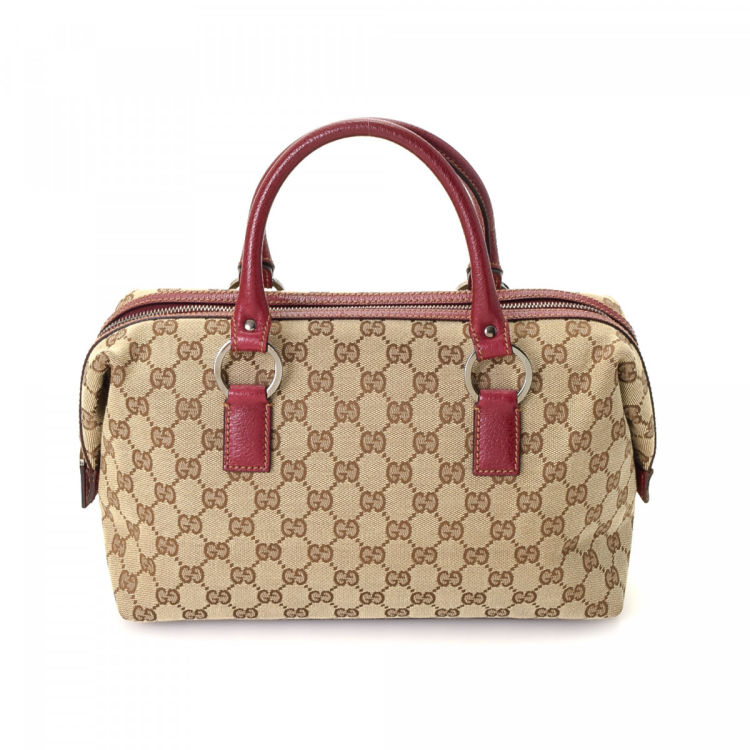 5faab62da6d LXRandCo guarantees the authenticity of this vintage Gucci handbag. Crafted  in gg canvas