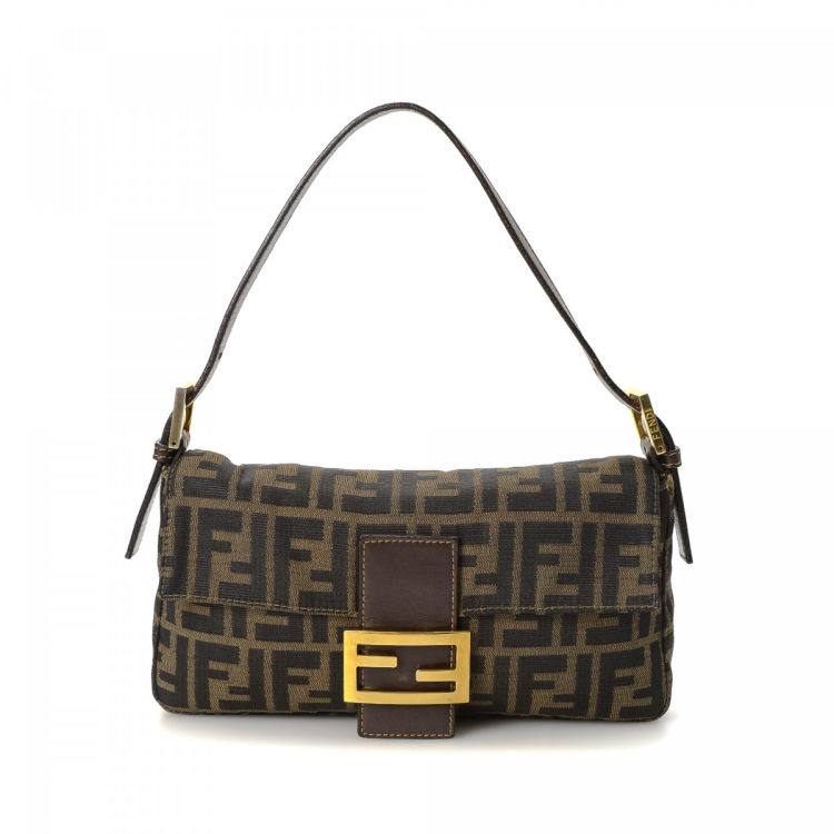 b3365733890d LXRandCo guarantees the authenticity of this vintage Fendi Baguette handbag.  Crafted in zucca canvas