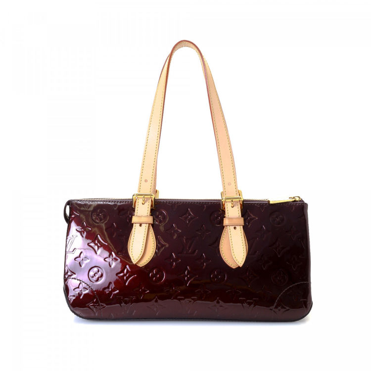 55975b53702f ... vintage Louis Vuitton Rosewood Avenue shoulder bag. This sophisticated  purse was crafted in monogram vernis patent leather in beautiful amarante.
