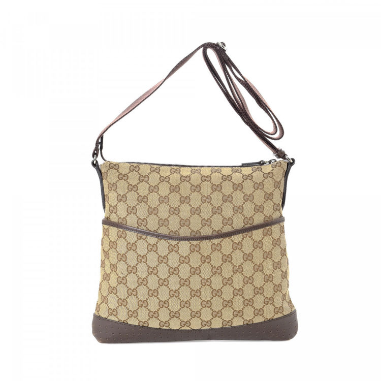 5dd01597427 The authenticity of this vintage Gucci Messenger Bag messenger   crossbody  bag is guaranteed by LXRandCo. This iconic crossbody was crafted in gg  canvas in ...