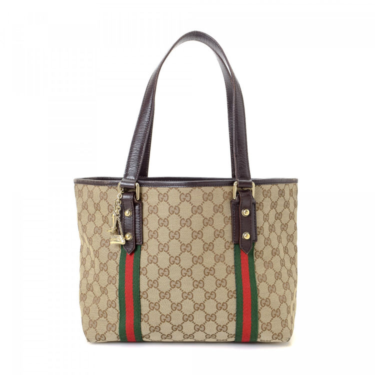 d4bca90cb34db5 LXRandCo guarantees the authenticity of this vintage Gucci Jolicoeur tote.  Crafted in gg canvas, this chic bag comes in beautiful beige.