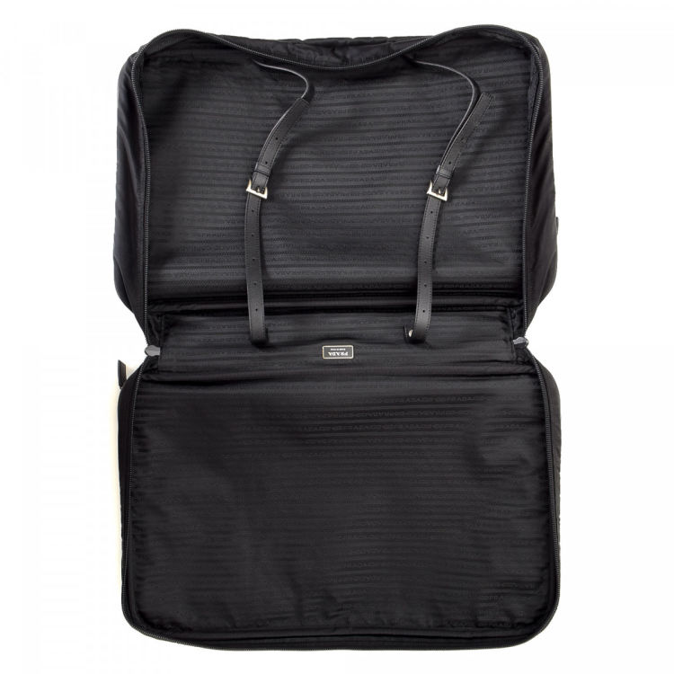 bef6702adbeb ... LXRandCo guarantees this is an authentic vintage Prada travel bag.  Crafted in tessuto nylon
