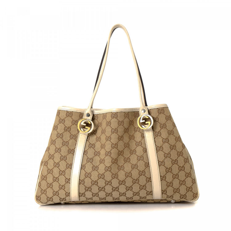 7f1028351f7 LXRandCo guarantees the authenticity of this vintage Gucci Twins tote.  Crafted in gg canvas