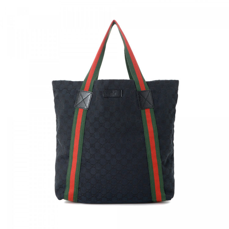 f2ecd97b3b9 LXRandCo guarantees this is an authentic vintage Gucci Web tote. This  elegant bag was crafted in gg canvas in black. Due to the vintage nature of  this ...