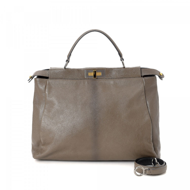 5a25f16cd103 LXRandCo guarantees this is an authentic vintage Fendi Peekaboo handbag.  This sophisticated purse comes in beautiful grey leather. Good condition   (AB)