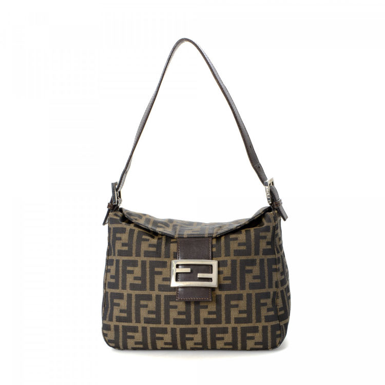 54b0de992f7c LXRandCo guarantees this is an authentic vintage Fendi Mama Baguette shoulder  bag. Crafted in zucca canvas