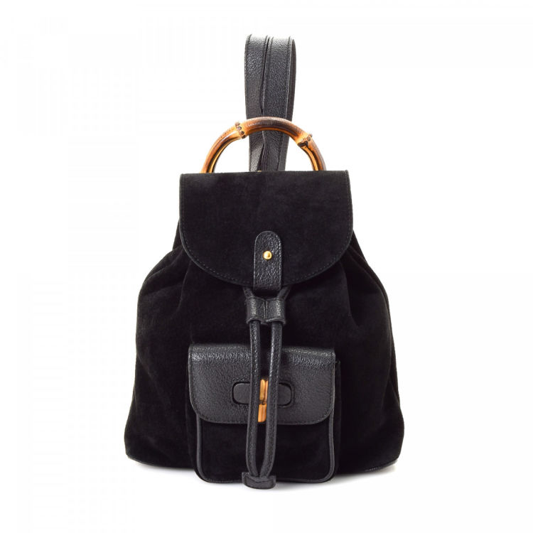 LXRandCo guarantees this is an authentic vintage Gucci Bamboo backpack.  Crafted in suede 1e8be52d9c319