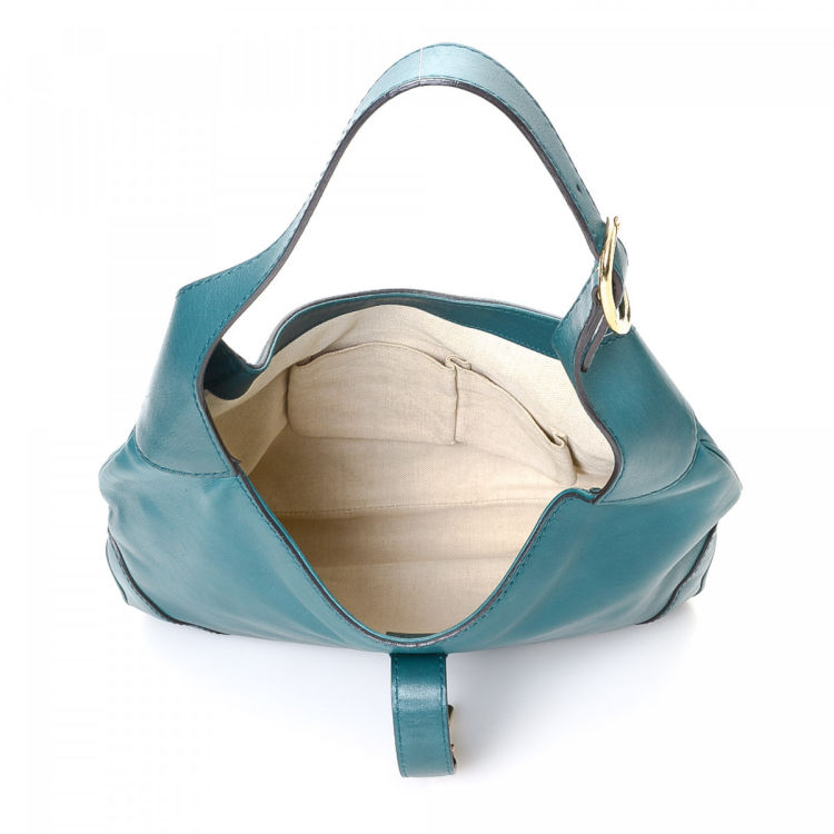 7c42f52f274b0c LXRandCo guarantees this is an authentic vintage Gucci New Jackie shoulder  bag. Crafted in leather, this stylish purse comes in teal.