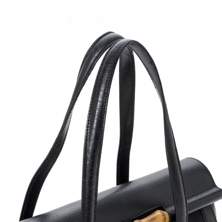 04f776337dd83 LXRandCo guarantees this is an authentic vintage Gucci Bamboo Bullet Bag  shoulder bag. This stylish satchel was crafted in gg canvas in black.