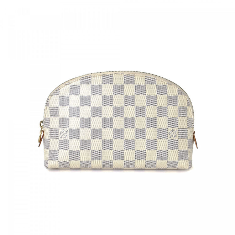 3b967489f91 The authenticity of this vintage Louis Vuitton Cosmetic Pouch GM vanity case    pouch is guaranteed by LXRandCo. Crafted in damier azur coated canvas