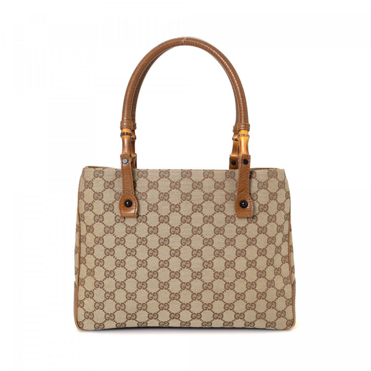 f858819f5a399e LXRandCo guarantees the authenticity of this vintage Gucci Bamboo handbag.  Crafted in gg canvas, this practical handbag comes in beautiful brown.