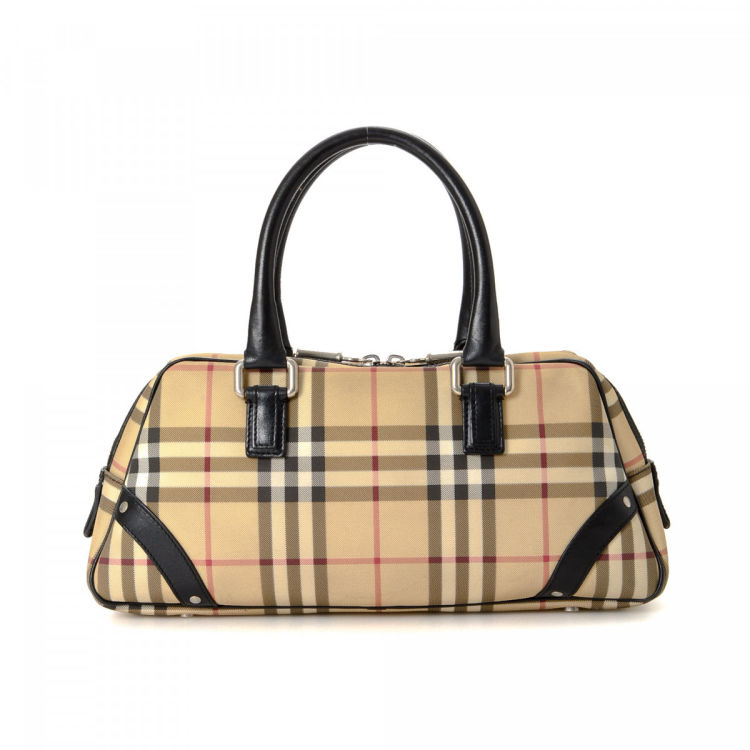 dd670b7fc9b9 LXRandCo guarantees this is an authentic vintage Burberry Vintage Check  handbag. This elegant purse in beige is made of canvas. Due to the vintage  nature of ...