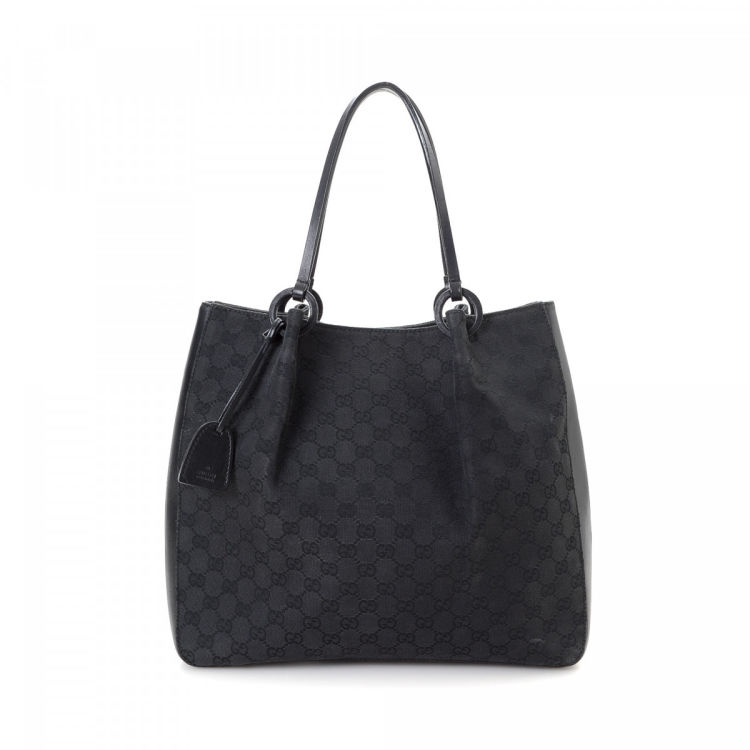 dd025545a4f LXRandCo guarantees the authenticity of this vintage Gucci tote. Crafted in gg  canvas