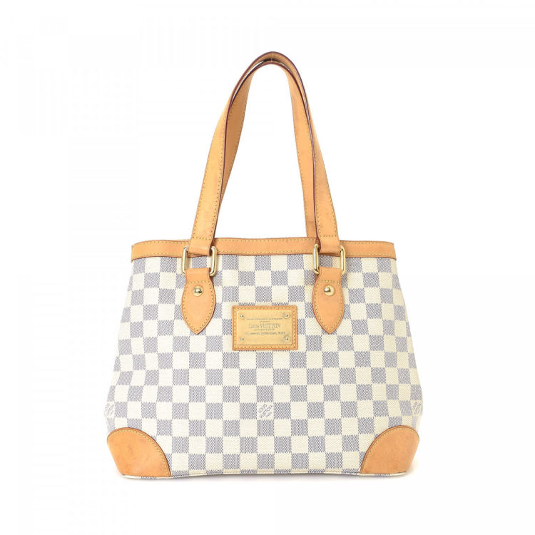 fd24f570297b The authenticity of this vintage Louis Vuitton Hampstead PM tote is  guaranteed by LXRandCo. Crafted in damier azur coated canvas