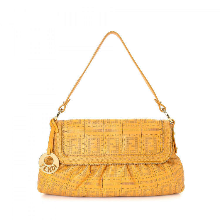 5ecc22216a5 The authenticity of this vintage Fendi Chef handbag is guaranteed by  LXRandCo. Crafted in zucca leather, this beautiful bag comes in yellow.