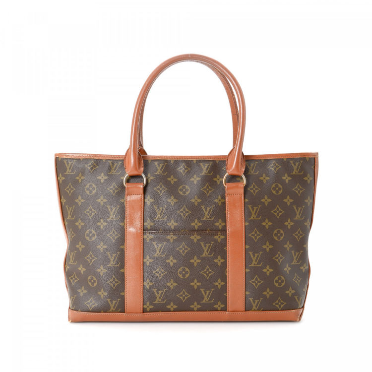 f6e634489 LXRandCo guarantees this is an authentic vintage Louis Vuitton Sac Weekend  PM tote. This luxurious tote bag in brown is made in monogram coated canvas.