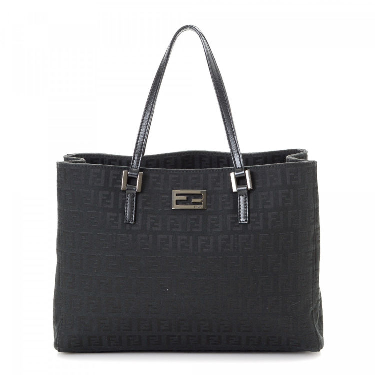 05be7ee30d LXRandCo guarantees the authenticity of this vintage Fendi Bag tote. This  chic tote bag was crafted in zucchino canvas in beautiful black.