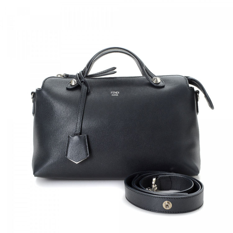 LXRandCo guarantees the authenticity of this vintage Fendi By the Way  shoulder bag. This beautiful satchel comes in black leather. Due to the  vintage nature ... 686097cc7b1d3