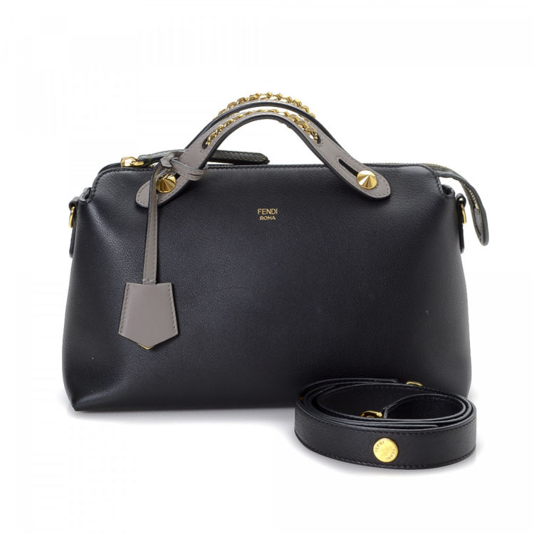 58e78d36b9 The authenticity of this vintage Fendi By The Way Boston Bag handbag is  guaranteed by LXRandCo. This stylish purse in black is made of leather.