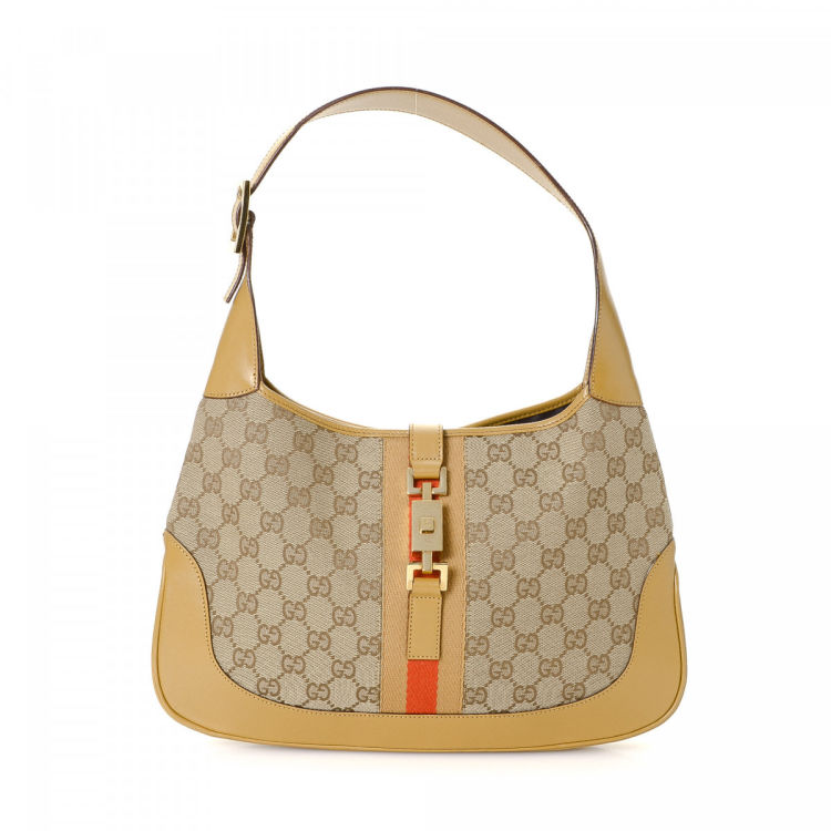 cf24b75fc3f The authenticity of this vintage Gucci Jackie handbag is guaranteed by  LXRandCo. Crafted in gg canvas