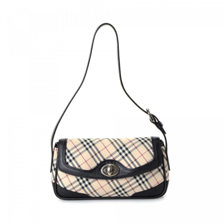 a78c47a4f39f LXRandCo guarantees the authenticity of this vintage Burberry shoulder bag.  This signature purse comes in beautiful multi color canvas.