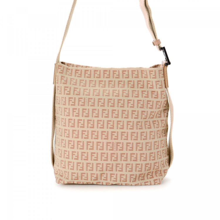 aebf9a9bd1 LXRandCo guarantees this is an authentic vintage Fendi Crossbody Bag  messenger   crossbody bag. This exquisite crossbody in pink is made in  zucchino canvas.
