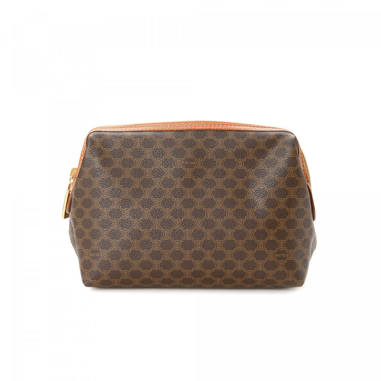 dd3c161669cc ... the authenticity of this vintage Céline Pouch vanity case   pouch.  Crafted in macadam coated canvas