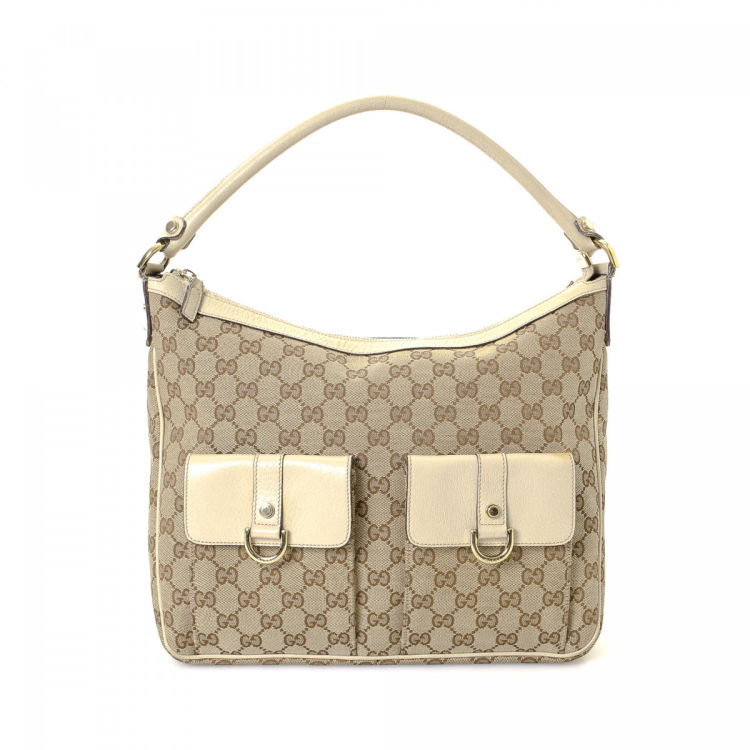 419a0ce7a93 The authenticity of this vintage Gucci shoulder bag is guaranteed by  LXRandCo. This sophisticated satchel in beige is made in gg canvas.