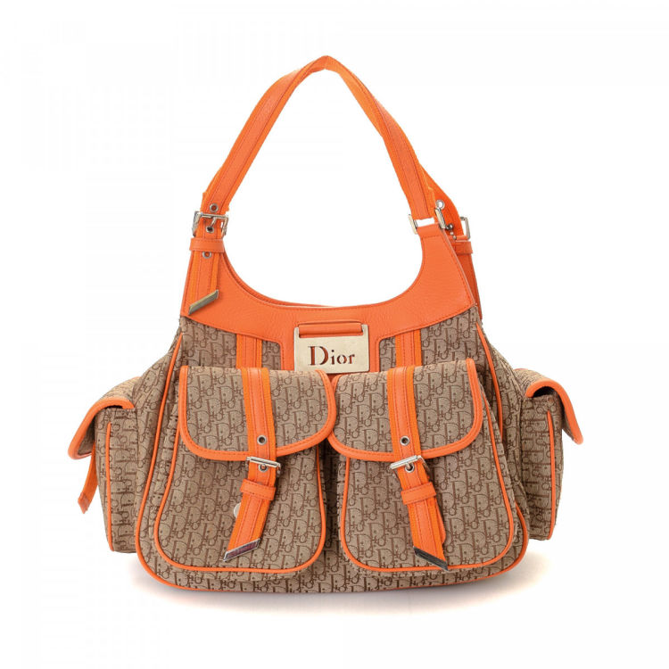 1fff3ce544b1 The authenticity of this vintage Dior shoulder bag is guaranteed by LXRandCo.  Crafted in trotteur canvas