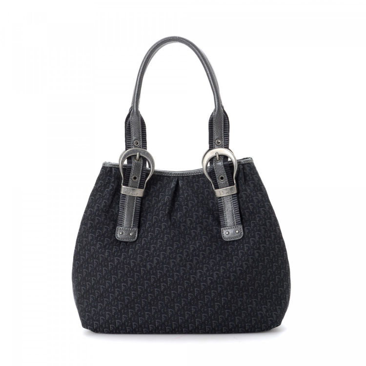 00758d6e6a22 The authenticity of this vintage Dior Trotteur shoulder bag is guaranteed  by LXRandCo. This signature bag in navy is made in trotter canvas.