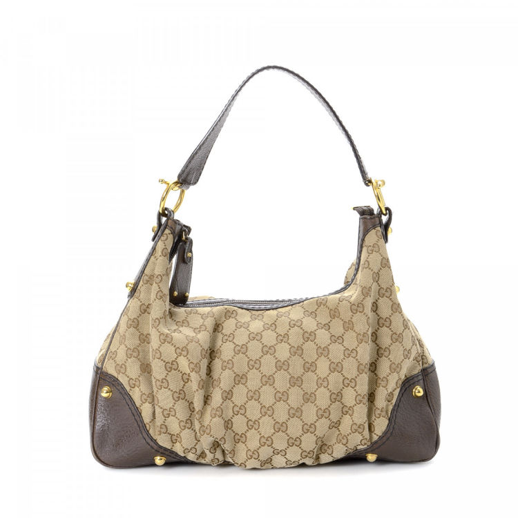 9d7e29e5a74 The authenticity of this vintage Gucci Jockey Hobo Bag shoulder bag is  guaranteed by LXRandCo. This exquisite purse in beige is made in gg canvas.