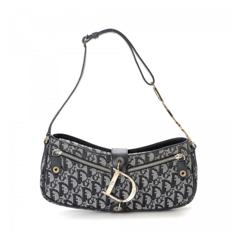67c88a62cb74 LXRandCo guarantees this is an authentic vintage Dior shoulder bag. This  signature purse was crafted in trotteur canvas in beautiful navy.