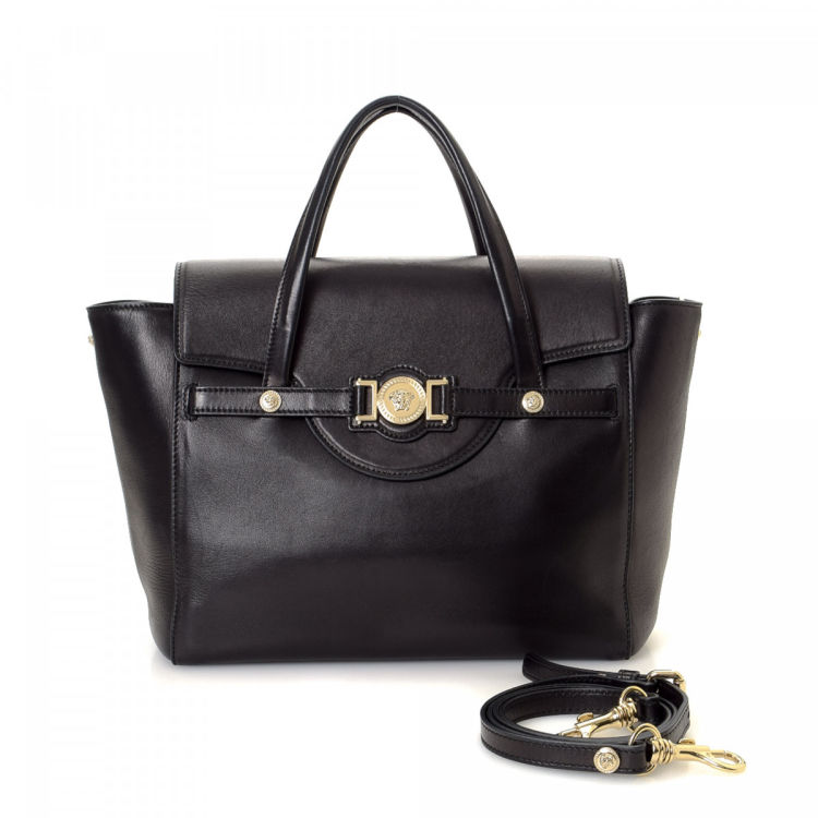 2ed60d243f0 LXRandCo guarantees the authenticity of this vintage Versace Medusa Bag tote.  This classic tote comes in black leather. Due to the vintage nature of this  ...