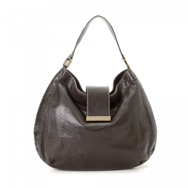 b08d1ba2367 The authenticity of this vintage Gucci Hobo Bag shoulder bag is guaranteed  by LXRandCo. This beautiful satchel was crafted in guccissima leather in  dark ...