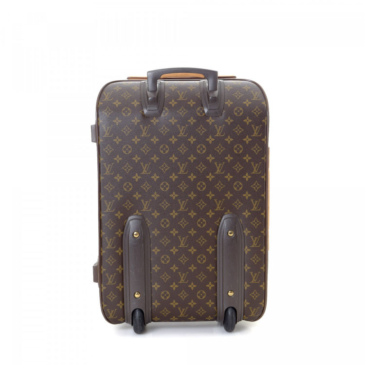 6c346c99b396 This product is in store at Stein Mart McAllen. LXRandCo guarantees this is  an authentic vintage Louis Vuitton Pegase 60 travel bag.
