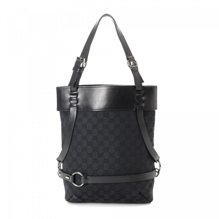 f48b94f47c1 LXRandCo guarantees the authenticity of this vintage Gucci Eclipse Bucket  Bag tote. This refined work bag was crafted in gg canvas in black.