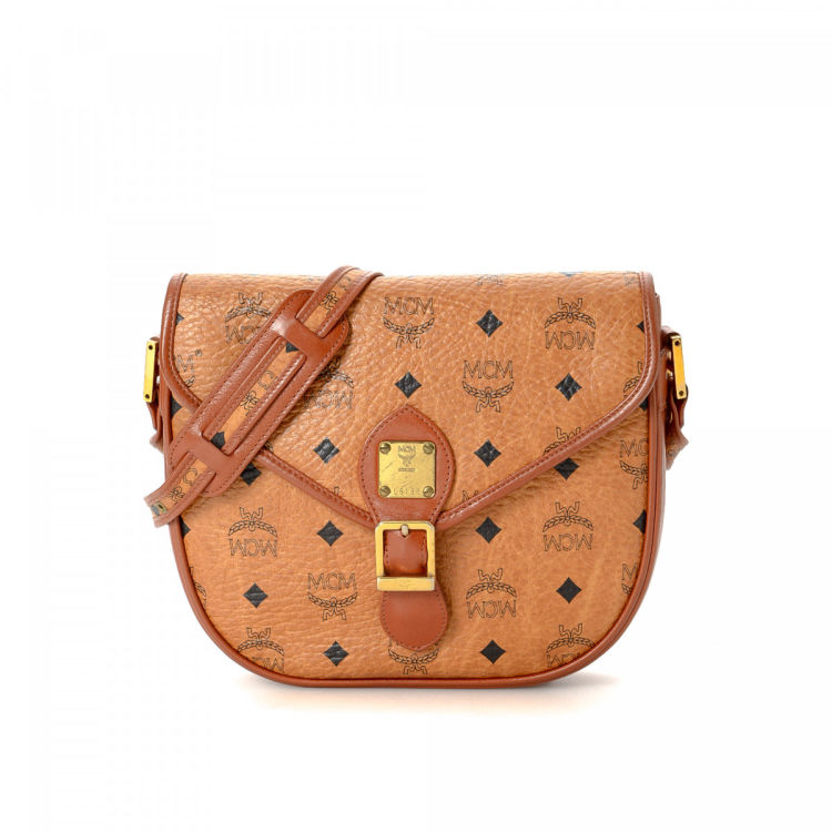 3863cf2a7 The authenticity of this vintage MCM shoulder bag is guaranteed by LXRandCo.  This beautiful satchel was crafted in visetos leather in cognac.