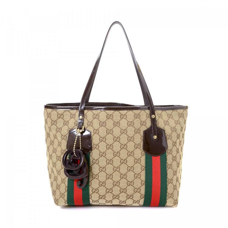 d7eeced47c6 LXRandCo guarantees the authenticity of this vintage Gucci Web tote.  Crafted in gg canvas
