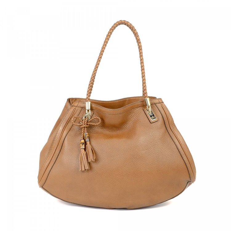 fc51a71c6b0c12 LXRandCo guarantees the authenticity of this vintage Gucci Bella Bag tote.  This elegant work bag in brown is made of leather. Very good condition* (A)