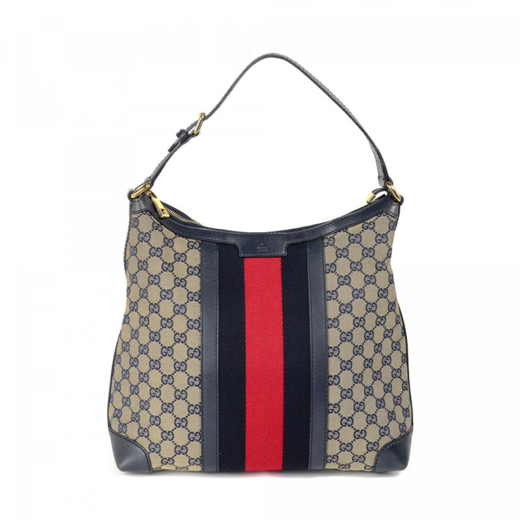 07220085a45 The authenticity of this vintage Gucci Web Shoulder Bag handbag is  guaranteed by LXRandCo. This chic handbag in beige is made in gg canvas.